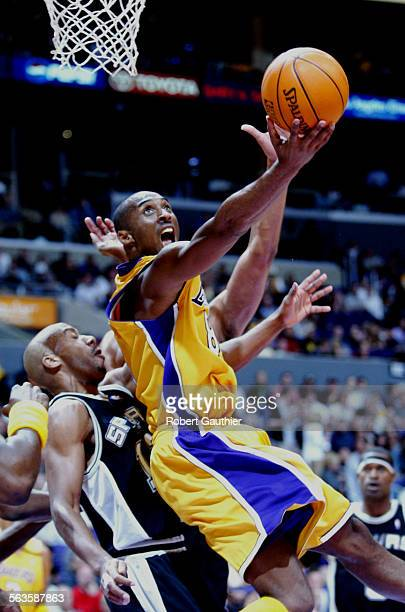 Laker Kobe Bryant makes a reverse dunk against the San Antonio Spurs Bruce Bowen in third quarter action in game 3 of the NBA Western Conference...