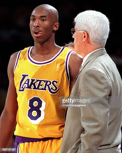 Laker rookie, 18–year–old Kobe Bryant listens to coach Del Harris during a break in the action during game earlier this season at the Forum.