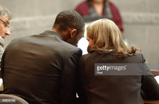 A Lakers basketball player Kobe Bryant and Pamela Mackey talk inside Courtroom one at the Eagle County Justice Center May 11 2003 in Eagle Colorado...