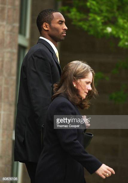 A Lakers basketball player Kobe Bryant leaves the Eagle County Justice Center with his attorney Pamela Mackey May 11 2003 in Eagle Colorado Bryant...
