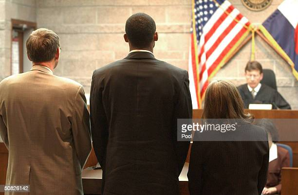 A Lakers basketball player Kobe Bryant stands before Judge Terry Ruckriegle with Hal Haddon and Pamela Mackey inside Courtroom one at the Eagle...