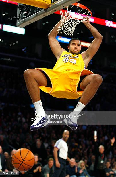 Lakers Brian Cook had a big game against the Heat as he slam dunks in the 1st quarter at the Staples Center Monday