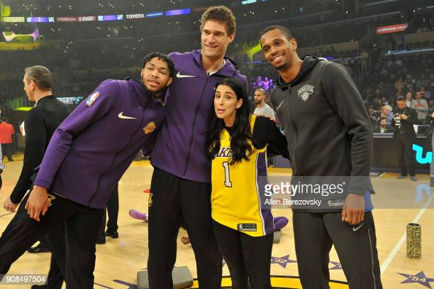 Lakers captains Brandon Ingram Brook Lopez honorary captain Sarah Silverman and Knicks captain Damyean Dotson pose for a picture at center court...