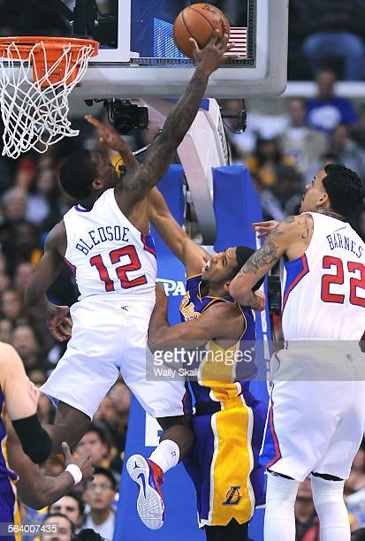 Lakers Darius Morris has his shot blocked by Clippers Eric Bledsoe as Matt Barnes helps on defense at the Staples Center Friday.