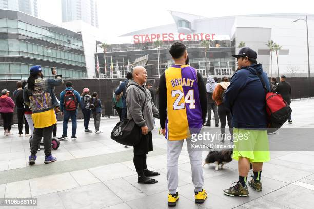 Lakers fans gather as they react to the news that former NBA player Kobe Bryant died in a helicopter crash outside the Staples Center January 26 2020...