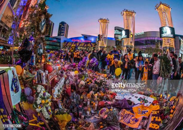 Lakers fans pay their respects at a Staples Center memorial to NBA legend Kobe Bryant who was killed last weekend in a helicopter accident in Los...