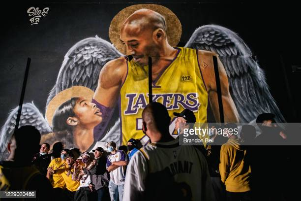 Lakers fans stand in line to celebrate in front of a mural of Kobe Bryant and his daughter Gianna Bryant on October 11, 2020 in Los Angeles,...