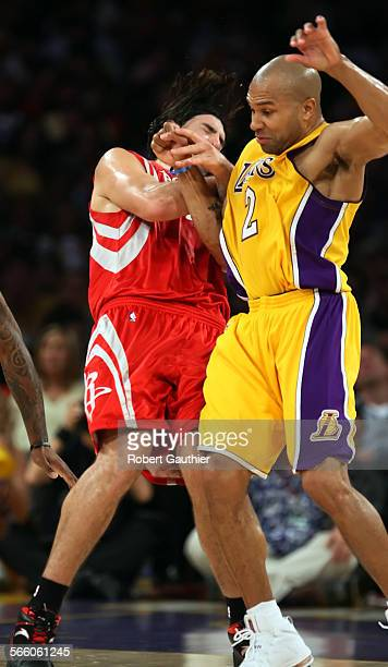 Lakers guard Derek Fisher slams into Rockets forward Luis Scola and is called for a technical foul resulting in his ejection late in game two of the...