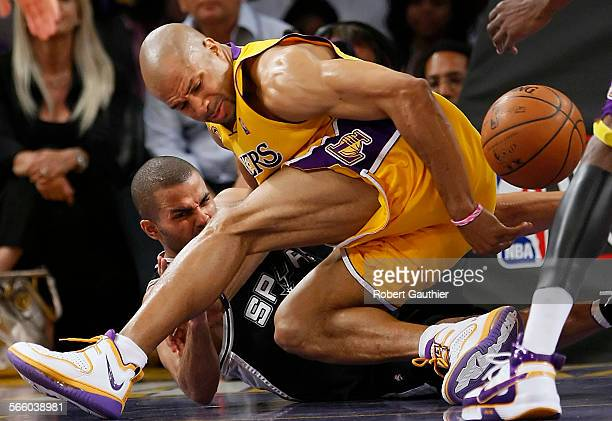Lakers guard Derek Fisher steals the ball from Spurs guard Tony Parker in the fourth quarter in the NBA Western Conference Finals on Wednesday May 21...