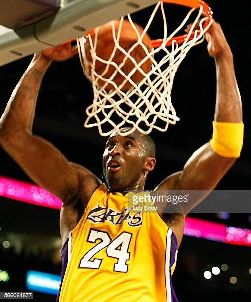 Lakers guard Kobe Bryant goes up for an uncontested dunk in the second quarter Thursday Nov 12 at Staples Center in Los Angeles