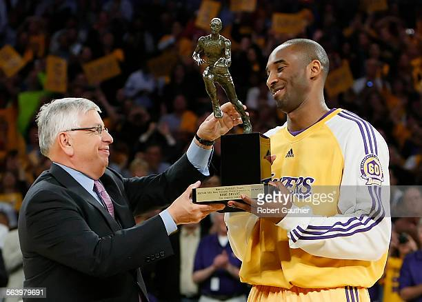 Lakers guard Kobe Bryant receives the NBA Most Valuable Player trophy from comissioner David Stern prior to game two of the Western Conference...