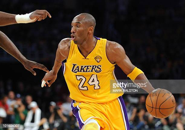 LA Lakers guard Kobe Bryant tries to get past Boston Celtics players during game one of the NBA finals at the Staples Center in Los Angeles on June 3...