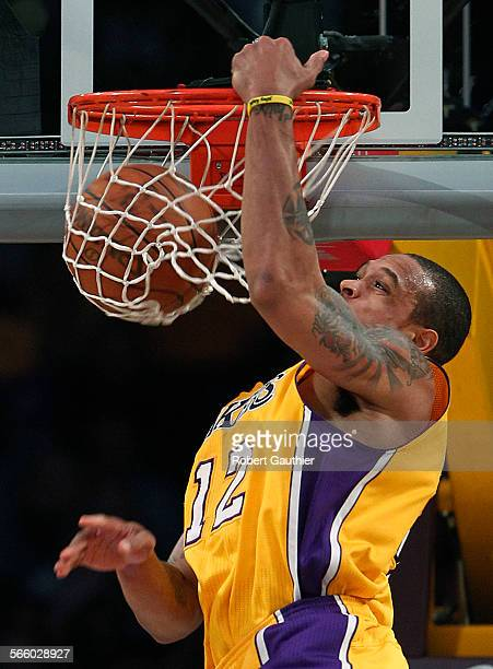 Lakers guard Shannon Brown slams home an alley oop dunk in the first half against the Utah Jazz at Staples Center .