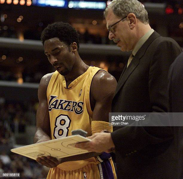 Lakers head coach Phil Jackson right plots strategy with Kobe Bryant during a game against Detroit at the Staples Center DIGITAL IMAGE SHOT