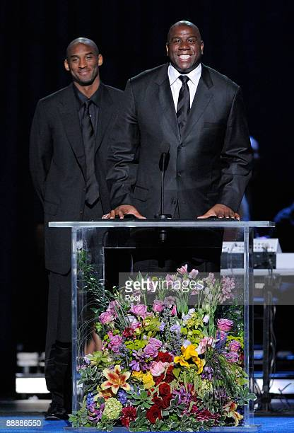 Lakers' Kobe Bryant and Magic Johnson speak during the Michael Jackson public memorial service held at Staples Center on July 7 2009 in Los Angeles...