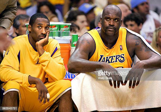 Lakers Kobe Bryant and Shaquille O'Neal sit on the bench with foul trouble against the Timberwolves in Game 6 of the Western Conference Finals at...