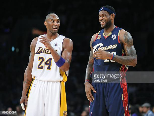 Lakers Kobe Bryant argues with a referee as Cavaliers LeBron James laughs at the Staples Center Friday