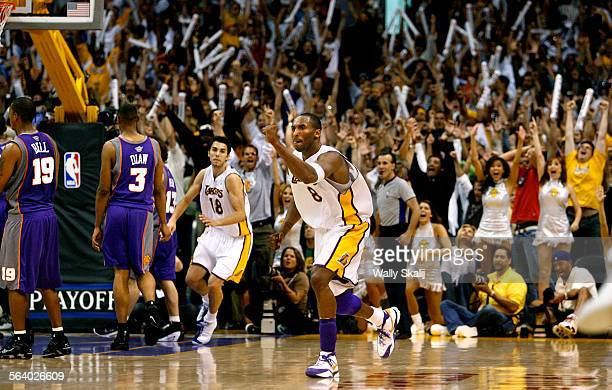 Lakers Kobe Bryant celebrates his game–winning shot in overtime against the Phoenix Suns in Game 4 of the Western Conference NBA Playoff first round...
