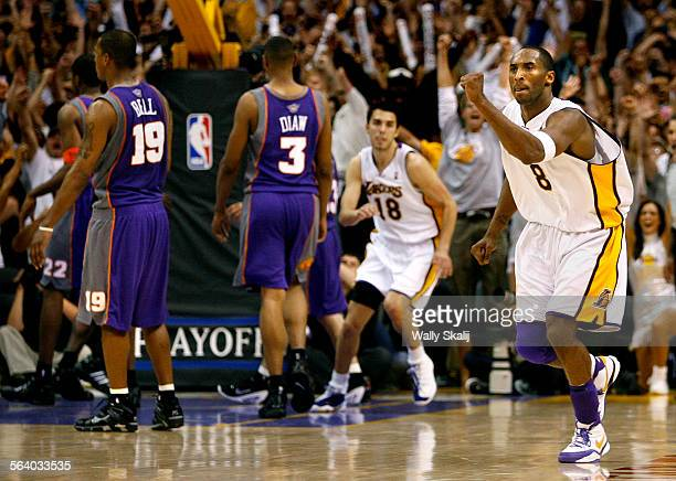 Lakers Kobe Bryant celebrates his game–winning shot in overtime against the Phoenix Suns in Game 4 of the NBA Western Conference first round playoffs...