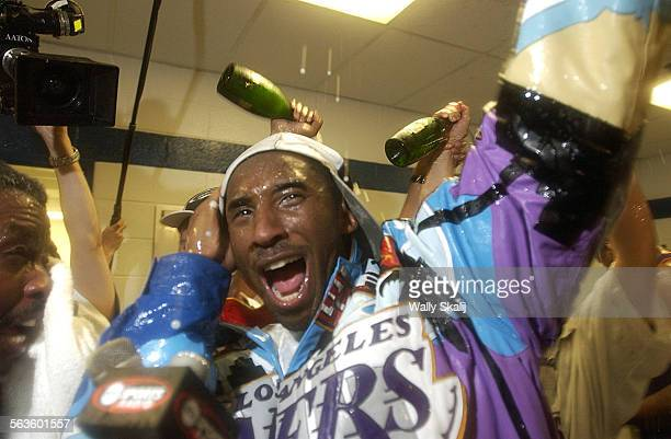 Lakers Kobe Bryant celebrates in the locker room after beating the New Jersey Nets for the championship of the NBA Finals Wednesday June 12 2002 at...