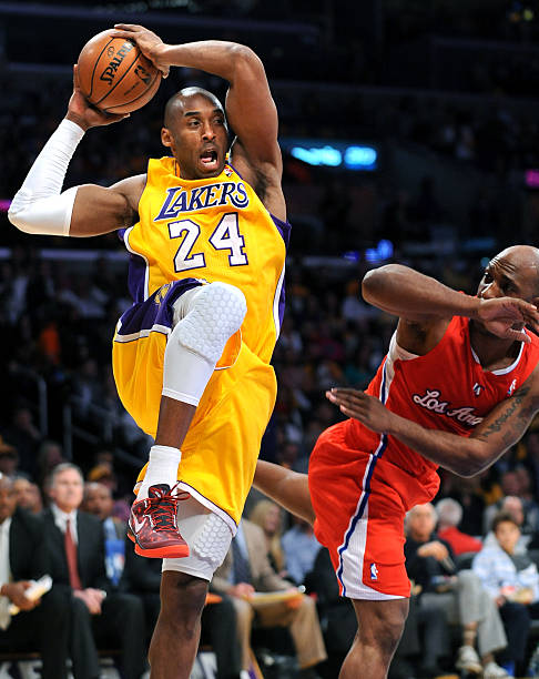 Lakers kobe bryant grabs a rebound form clippers chauncey billups lakers kobe bryant grabs a rebound form clippers chauncey billups at the staples center thursday voltagebd Images