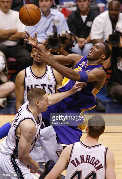 Lakers Kobe Bryant looses the handle to the ball against the New Jersey Nets Aaron Williams driving to the basketduring Game 4 of the NBA Finals in...