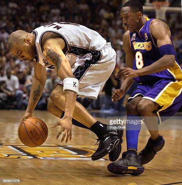 Lakers Kobe Bryant pressures Nets Kenyon Martin in the fourth quater in Game 3 of the NBA Finals in New Jersey Sunday June 9 2002