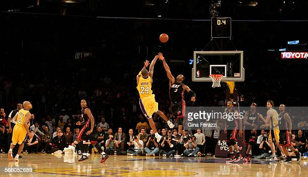 Lakers Kobe Bryant scores the winning shot over Miami Heat Dwyane Wade with 04 seconds left on the clock to win 108–107 at Staples Center