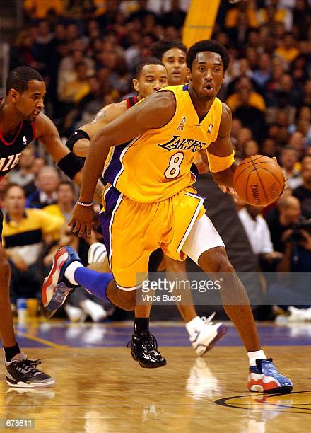 Laker's Kobe Bryant wears a pair of red white and blue shoes during the Los Angeles Lakers versus the Portland Trail Blazers basketball game October...