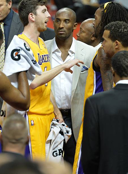 Lakers kobe bryant c who is out injured looks on as teammate lakers kobe bryant c who is out injured looks on as teammate ryan kelly l talks during a time out of the basketball match between the los angeles voltagebd Images