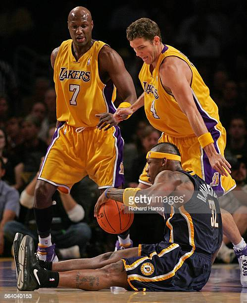 Indiana pacer center getty images lakers lamar odom top left and luke walton defend as indiana pacer al harrington tries to voltagebd Images
