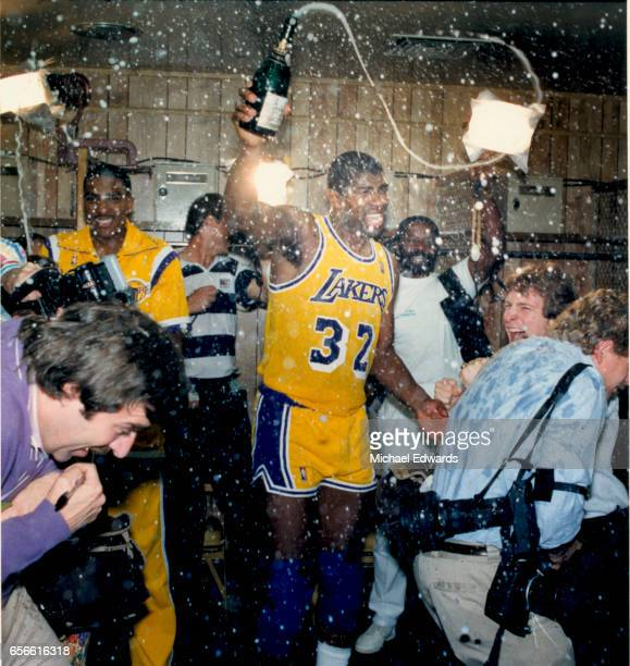 Lakers Magic Johnson celebrates in the locker room in 1987 after defeating the Boston Celtics to win another NBA championship