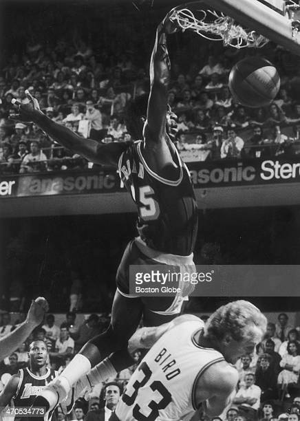 Lakers player AC Green slam dunks one over the Celtics' Larry Bird as the Boston Celtics play the Los Angeles Lakers in an NBA finals game at Boston...