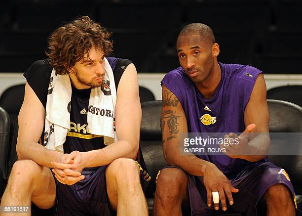 Lakers' players Pau Gasol and Kobe Bryant chat during a practice session at the Staples Center in Los Angeles California on June 3 on the eve of the...