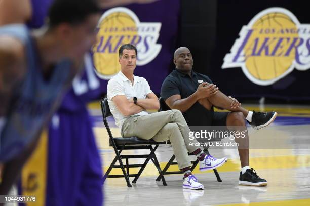 Lakers President of Basketball Operations Earvin 'Magic' Johnson and General Manager Rob Pelinka look on at practice at UCLA Health Training Center...