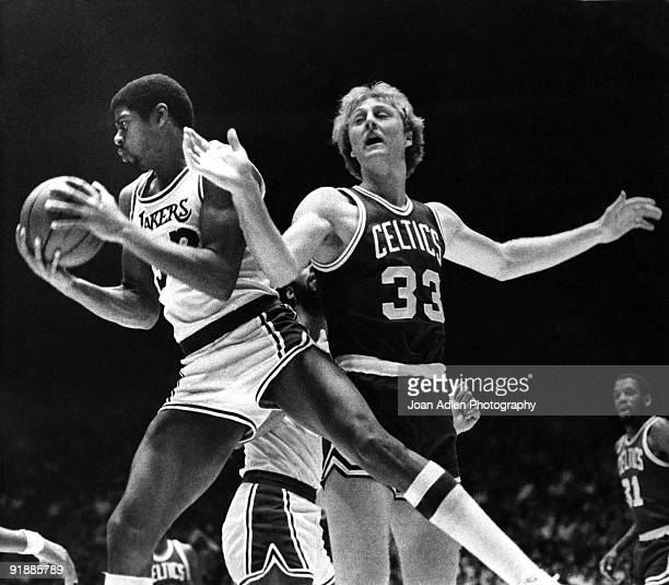 Lakers rookie Magic Johnson rips a rebound from the hands of Boston Celtics rookie Larry Bird during the first half at the Forum on October 28, 1979...