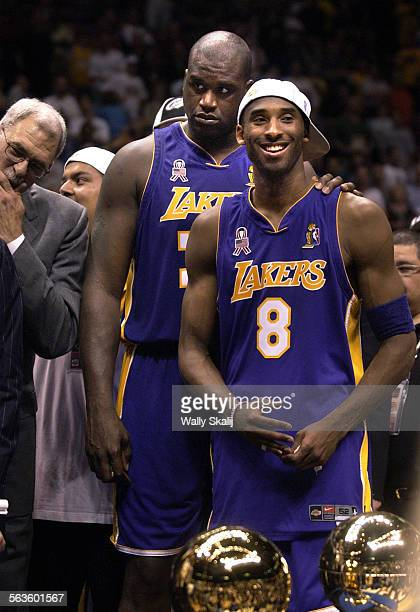 Lakers Shaquille O'Neal and Kobe Bryant wait to receive their trophys after defeating the Nets in Game 4