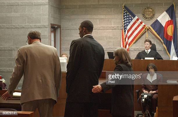 A Lakers Star Kobe Bryant gets ready to leave courtroom one with his council Hal Haddon and Pamela Mackey after pleading not guilty before Judge...