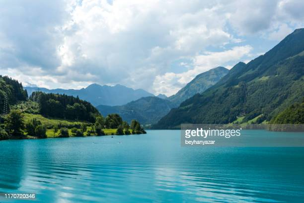 lakescape of lake lucerne, burglen town in nidwalden canton, switzerland - schwyz stock pictures, royalty-free photos & images