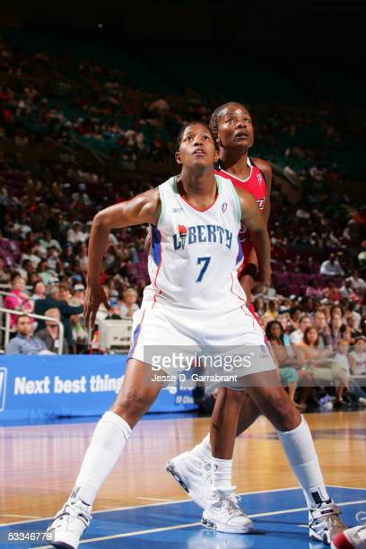 La'Keshia Frett of the New York Liberty boxes out for rebound position against Sheryl Swoopes of the Houston Comets July 27 2005 at Madison Square...