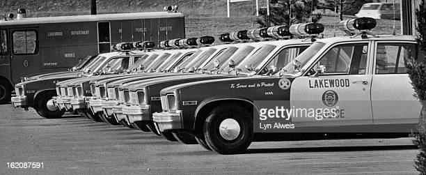 MAR 26 1979 JUL 18 1980 Lakewood Colorado Police Department Department of Public Safety Cars Lined Up Outside City Hall Lakewood police cars have...