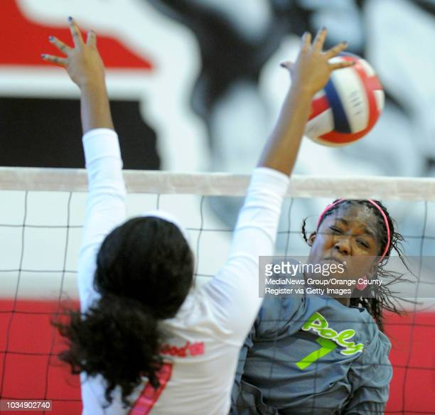 Lakewood's Amanda Henderson left block a shot by Poly's Erin Williams in Lakewood CA on Thursday October 16 2014 Lakewood girls...