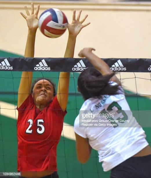 LakewoodÕs Julia Crawford blocks a spike by PolyÕs Taylor Walker in Long Beach on Tuesday October 17 2017