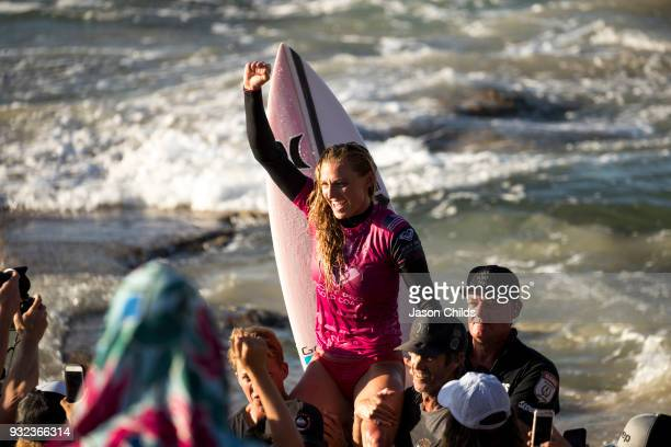 Lakey Peterson is carried up the beach after she claimed victory today in extraordinary conditions at Kirra on the Gold Coast of Australia March 15...