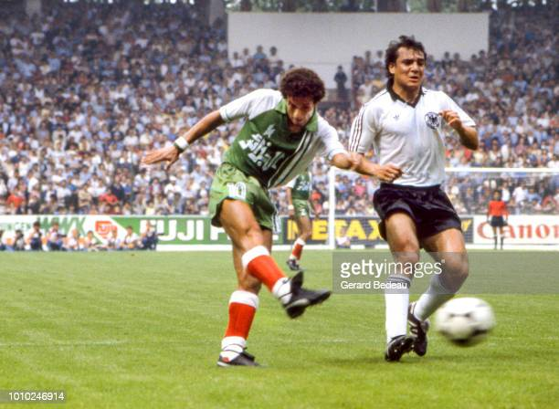 Lakhdar Belloumi of Algeria and Felix Magath of Germany RF during the World Cup match between Germany RF and Algeria at El Molinon Gijon Spain on...