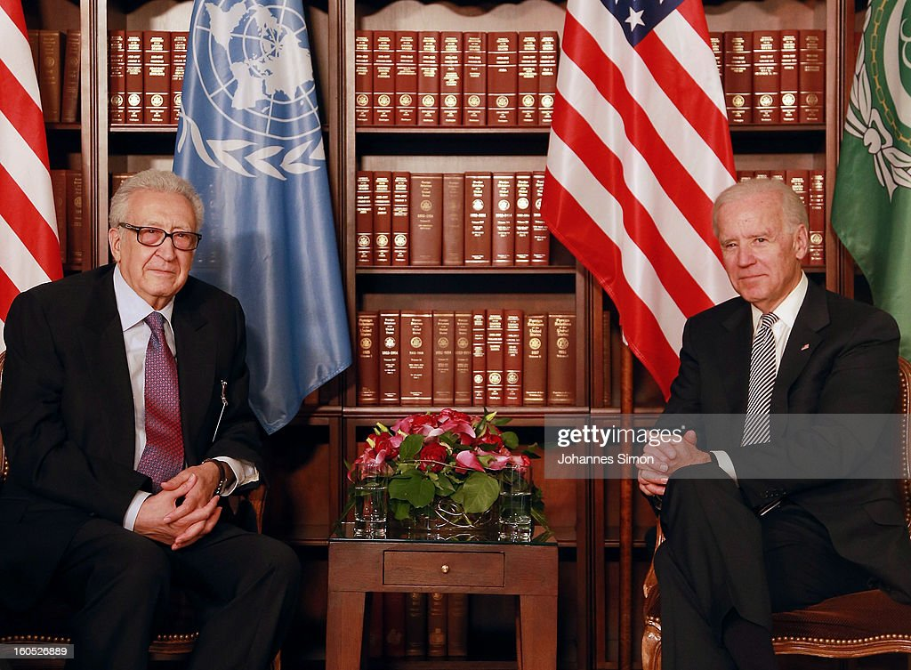 Lakhdar Brahimi (L), UN joint special representative, and U.S. vice president Joe Biden pose ahead of a bilateral meeting at Hotel Bayerischer Hof on February 2, 2013 in Munich, Germany. The Munich Security Conference brings together senior figures from around the world to engage in an intensive debate on current and future security challenges and remains the most important independent forum for the exchange of views by international security policy decision-makers.