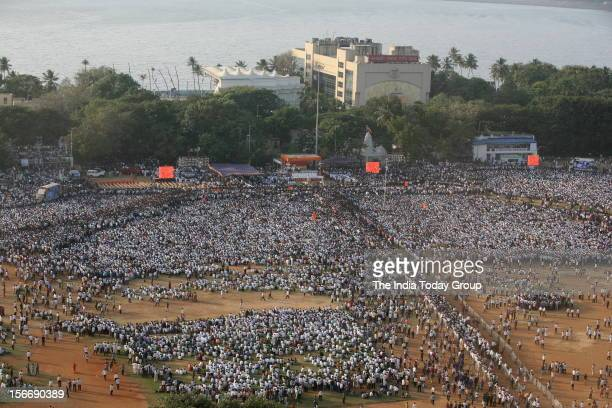 Lakhs of people including Shiv Sena supporters thronged the funeral procession of party chief Bal Thackeray in Mumbai on Sunday November 18 2012