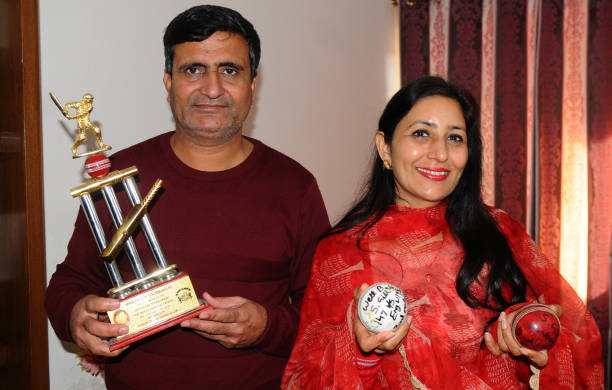 Lakhwinder Singh and Kirath Gill parents of cricketer Shubman Gill with sons trophy and balls at their home Sector 70 in SAS Nagar on January 30 2018.