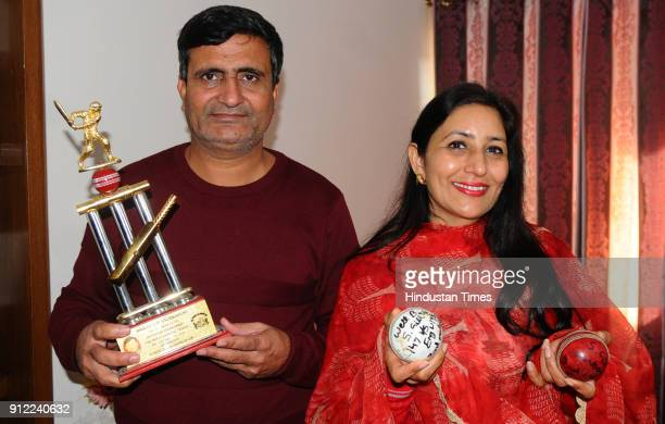 Lakhwinder Singh and Kirath Gill parents of cricketer Shubman Gill with sons trophy and balls at their home Sector 70 in SAS Nagar on January 30 2018...