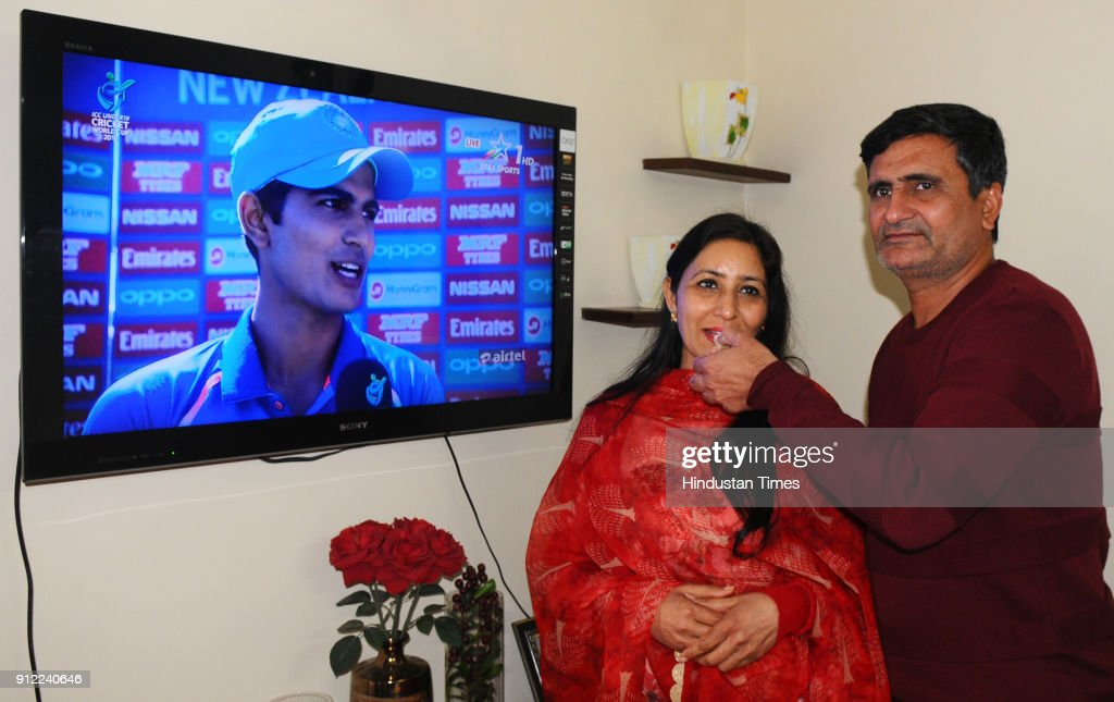 Lakhwinder Singh and Kirath Gill parents of cricketer Shubman Gill watching their son as he scored an unbeaten 102 runs against Pakistan in U19 World.